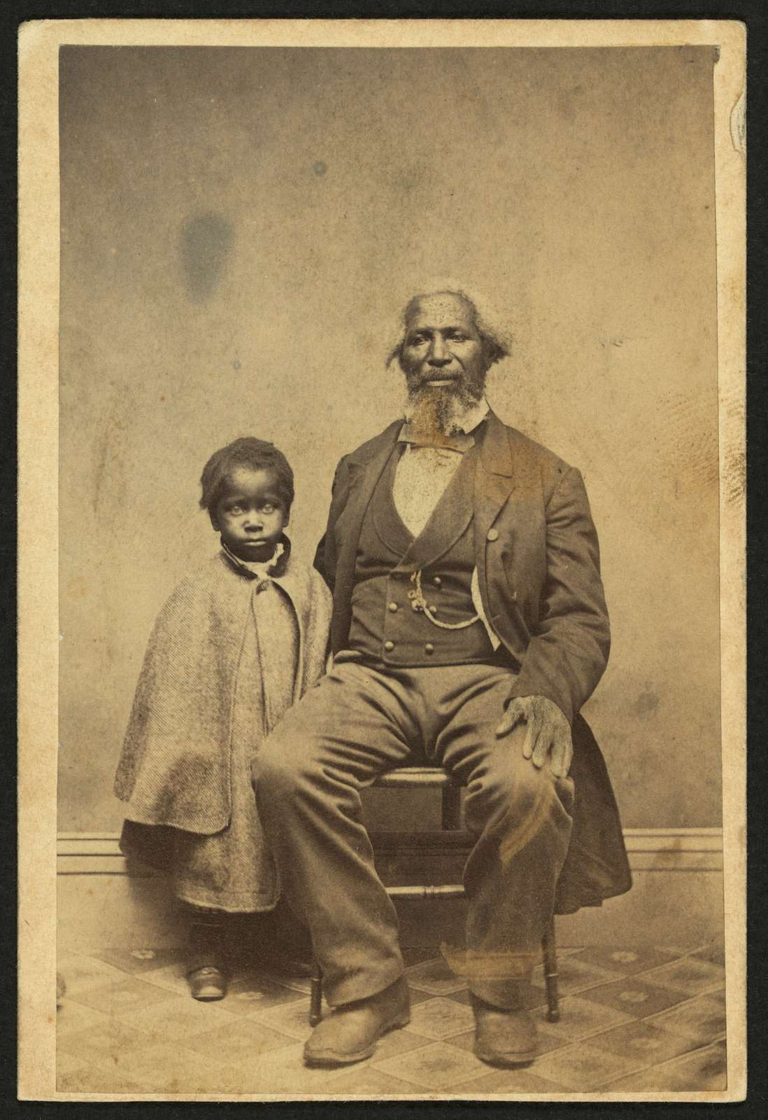 [African American man and child, full-length portrait, facing front] / Bundy & Williams, photographers, Middleton, Conn.