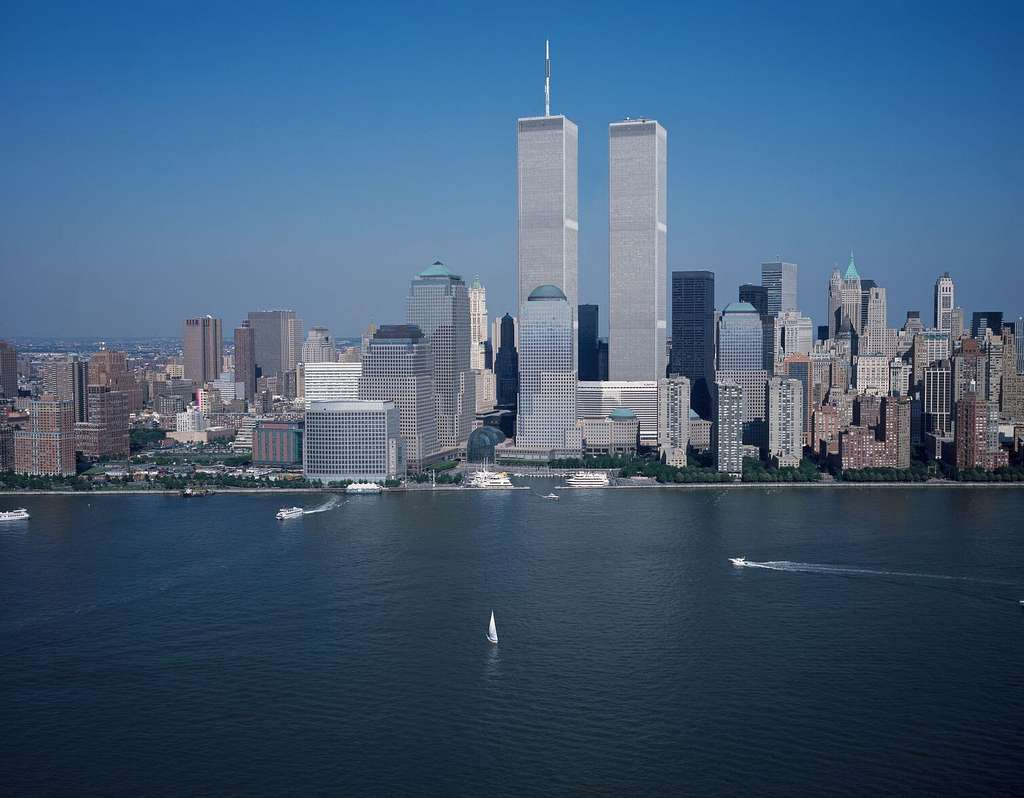 [Aerial view of New York City, in which the World Trade Center Twin Towers is prominent]