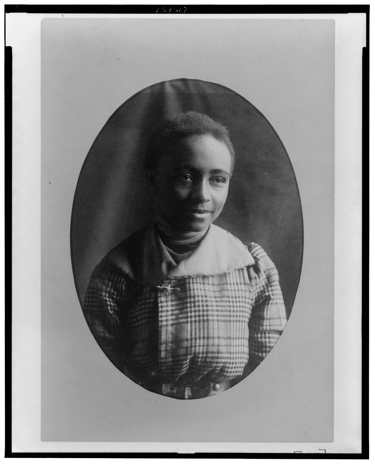 [African American woman, half-length portrait, facing front, smiling]