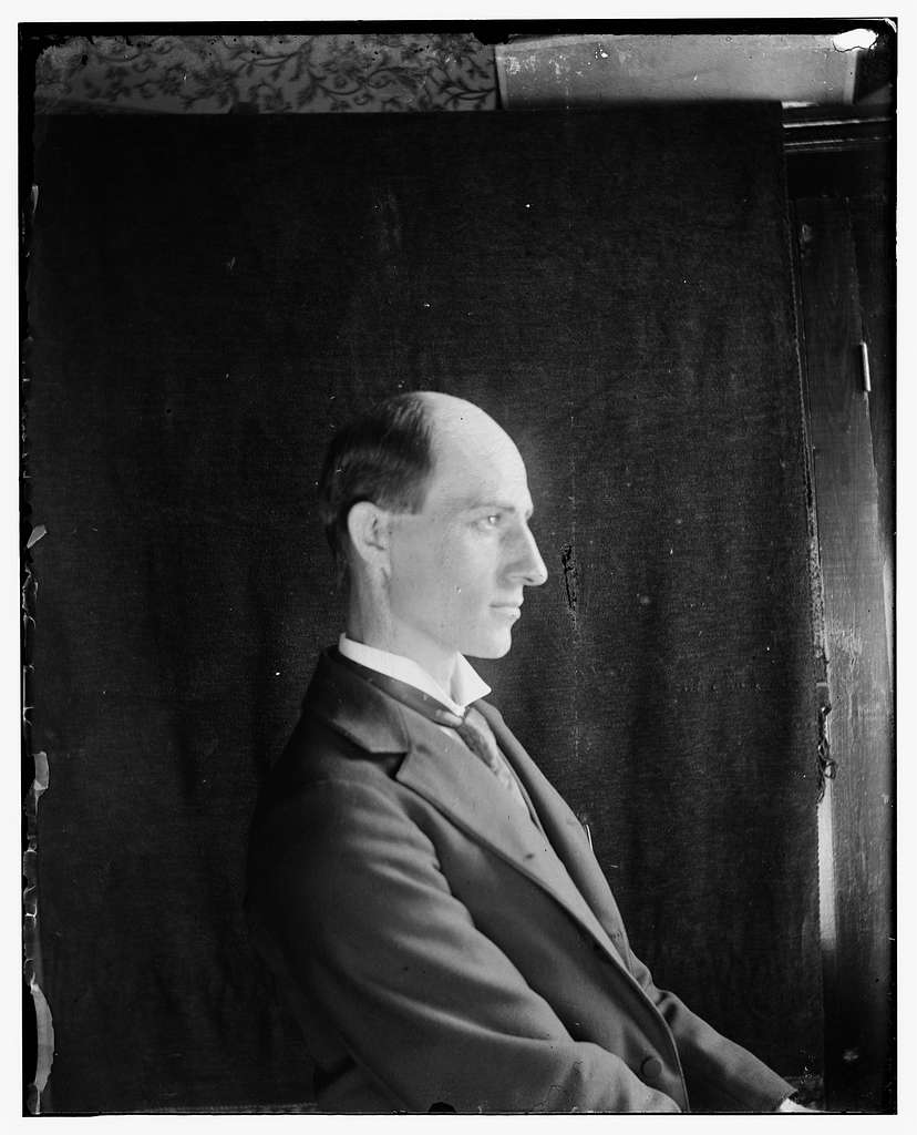 [Wilbur Wright, age 30, seated facing right, half-length side view]