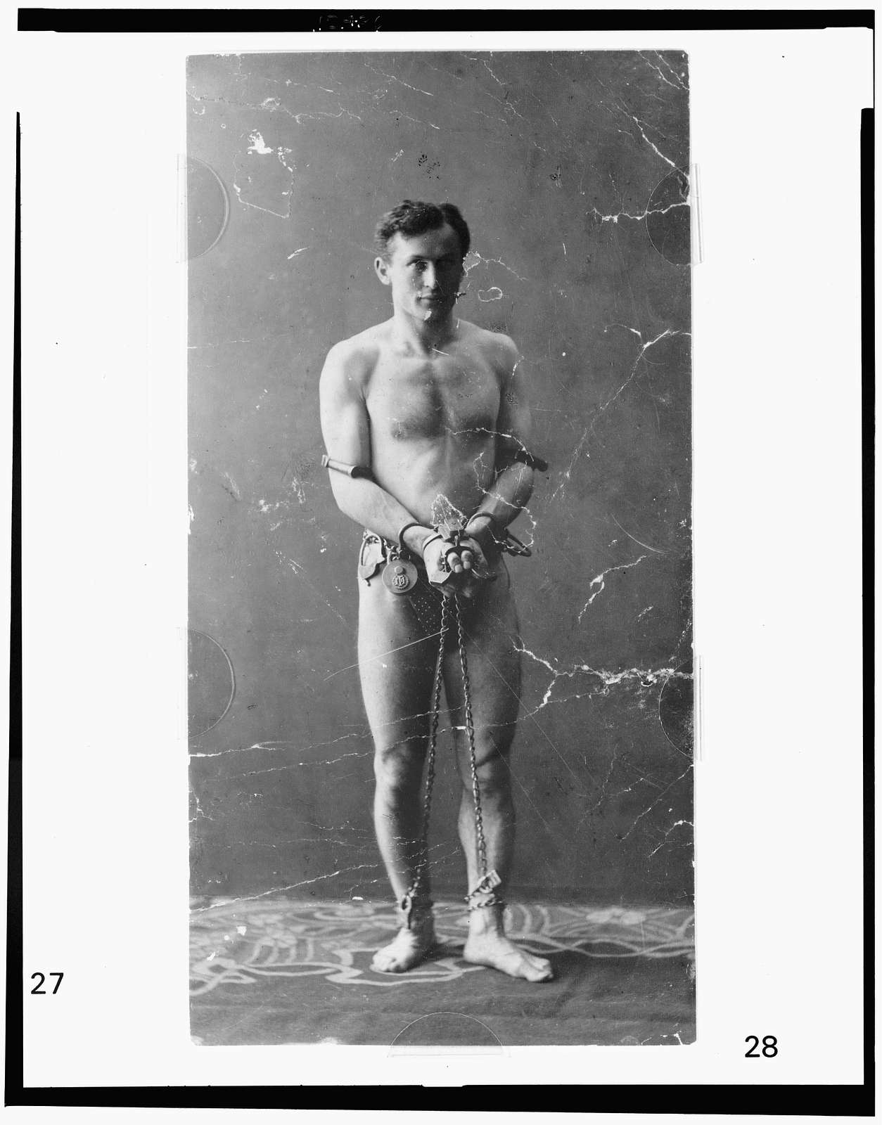 [Harry Houdini, full-length portrait, standing, facing front, in chains]