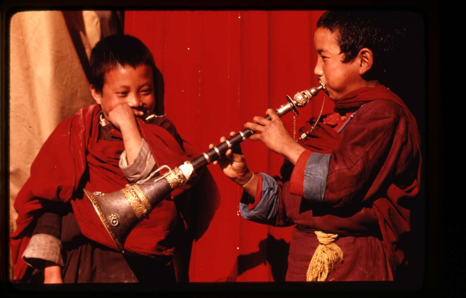 [Young lamas learn to play horns, Sikkim]