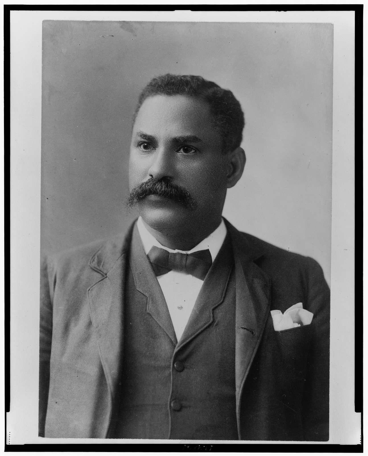 [African American man, half-length portrait, facing slightly left]