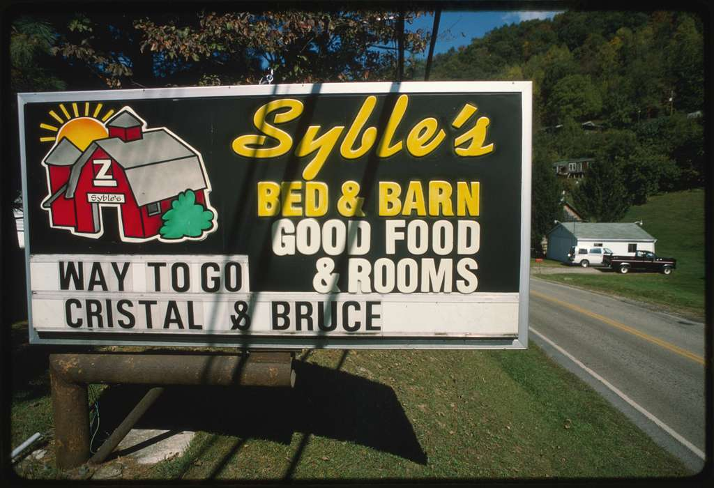 Sign in front of Syble's Bed & Barn congratulating Crystal Pettry and Bruce Ramsey on their wedding