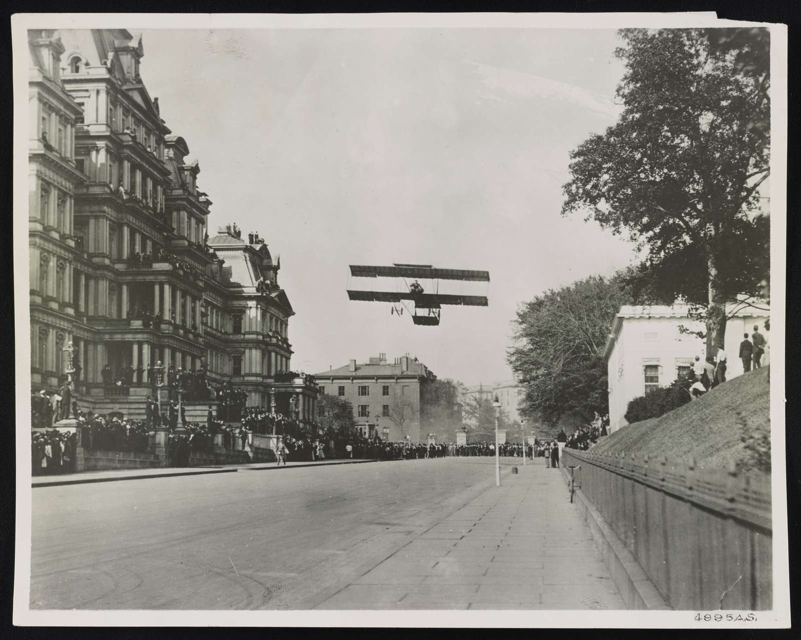 Claude Graham White [i.e. Grahame-White] flying his Farman biplane along W. Executive Ave., Washington, D.C., Oct. 14, 1910
