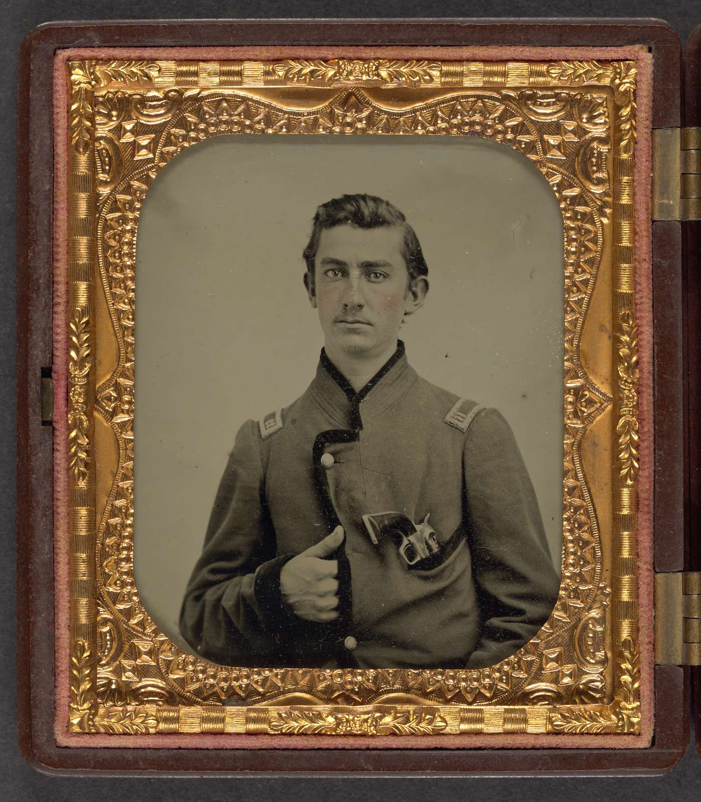 [Unidentified soldier in Union captain's uniform with revolver in breast pocket]