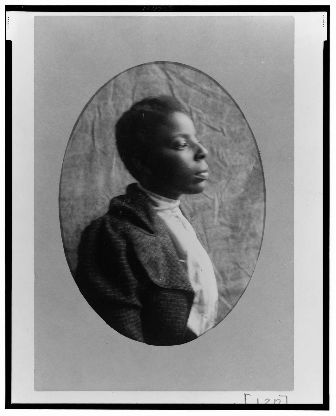 [African American woman, head-and-shoulders portrait, right profile]