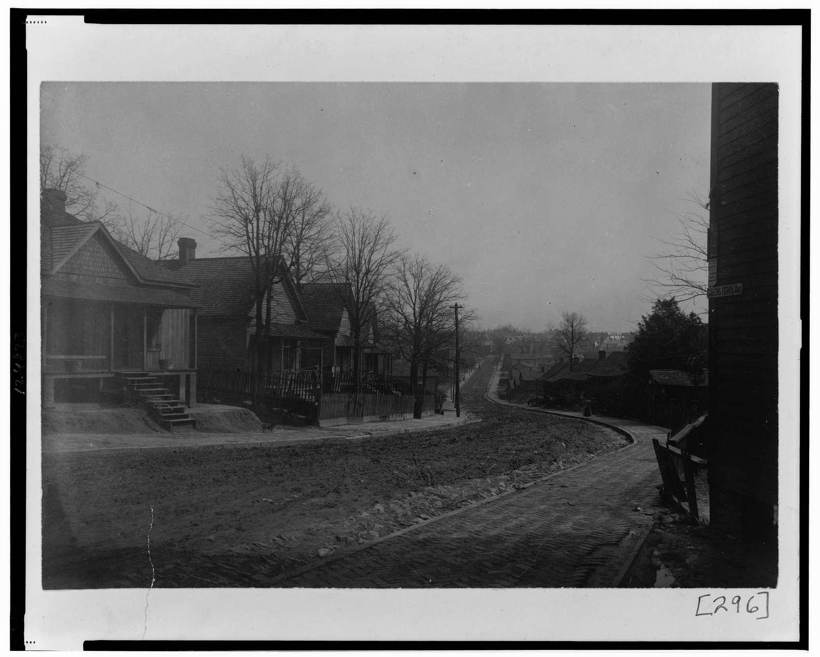 [Exterior view of houses along unpaved street, Greensferry Ave., N.W., Atlanta, Georgia]