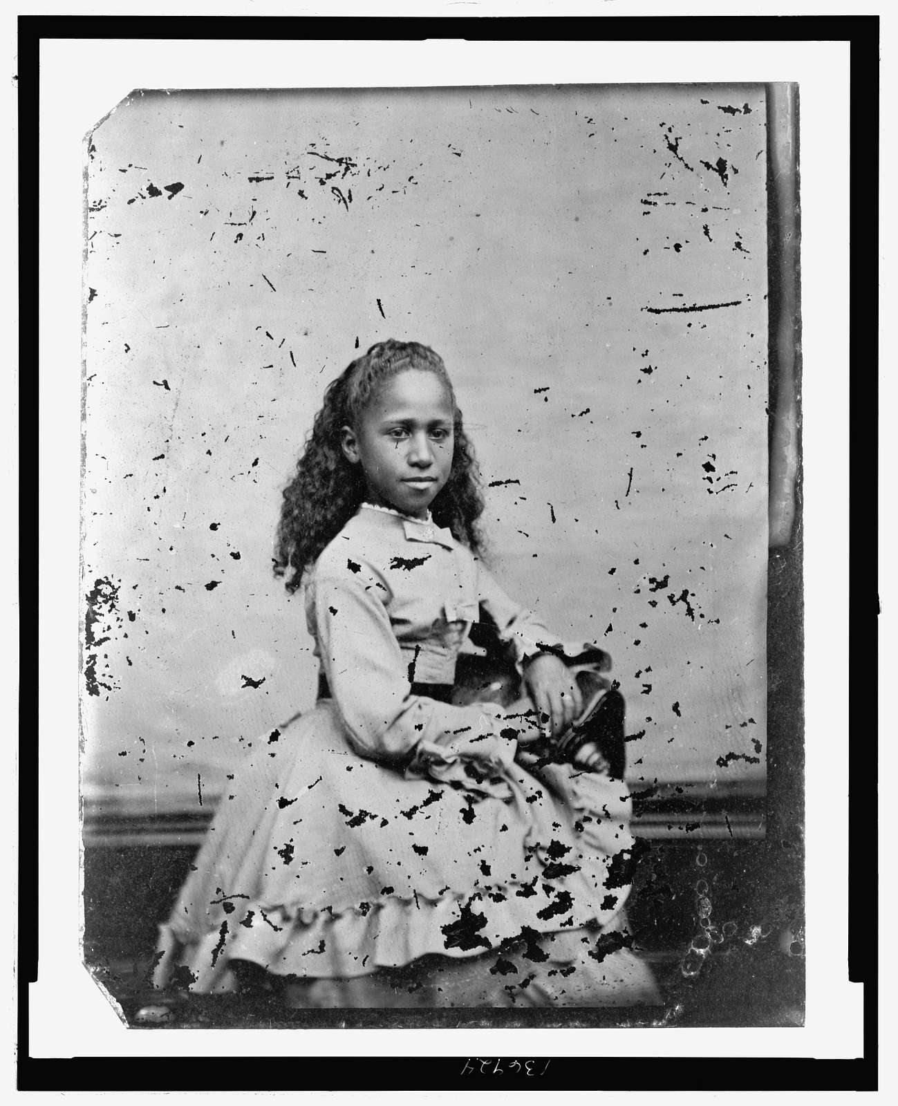 [Portrait of African American girl, seated]