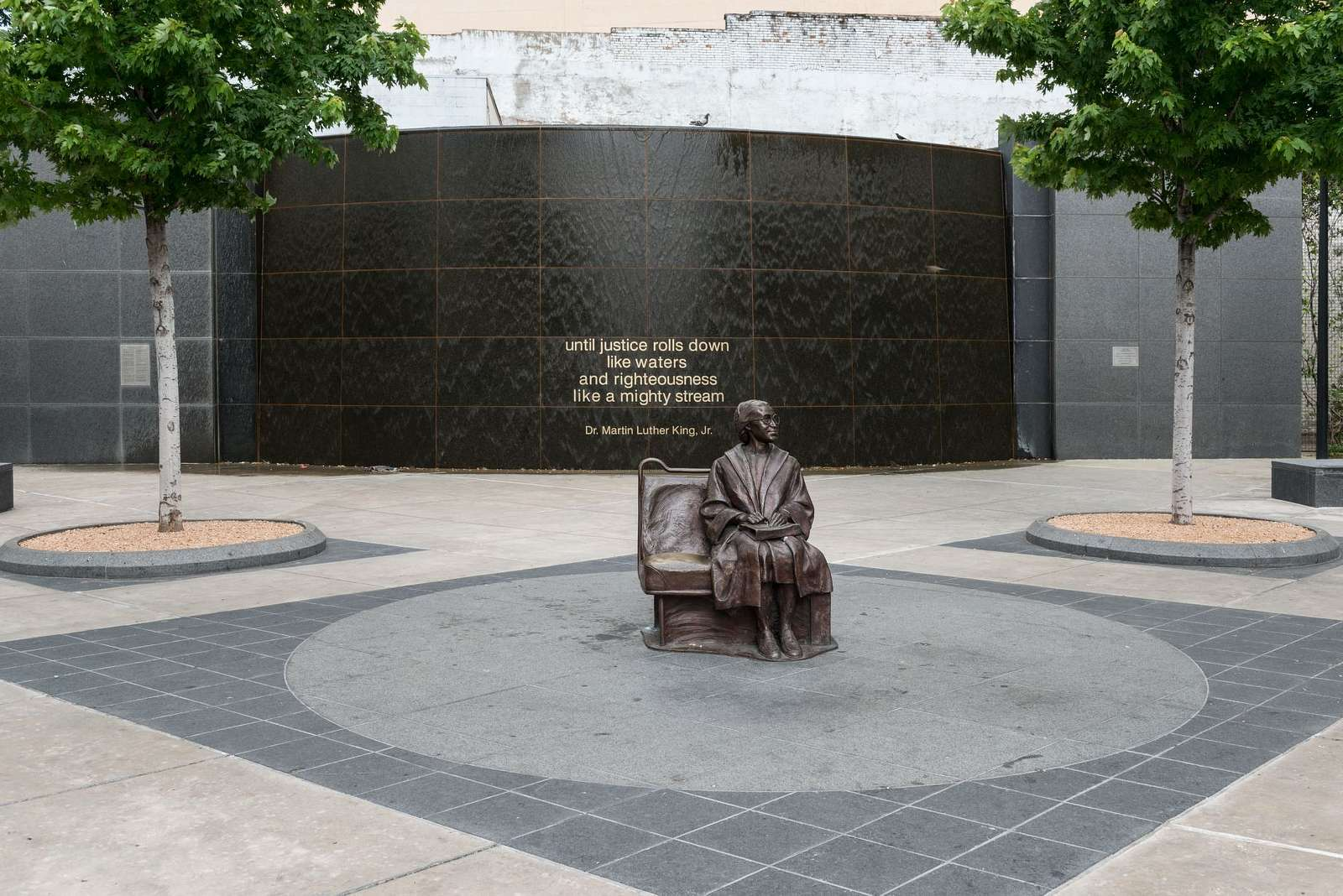 A life-size bronze statue of African-American civil-rights stalwart Rosa Parks, sitting on a bus bench, the focal point of a plaza at a Dallas Area Rapid Transit, or DART, station that was completed in 2009 in Dallas, Texas