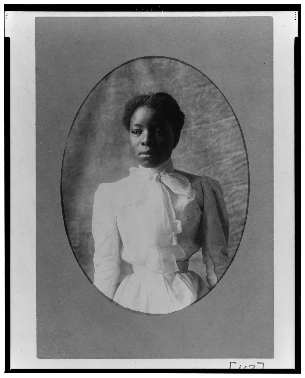 [African American woman, half-length portrait, facing slightly left]