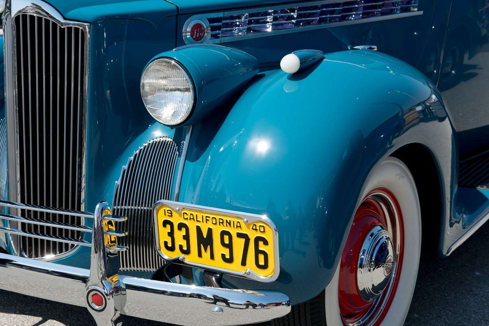 Detail of a historic car with license plates from the 1940s. San Francisco, California
