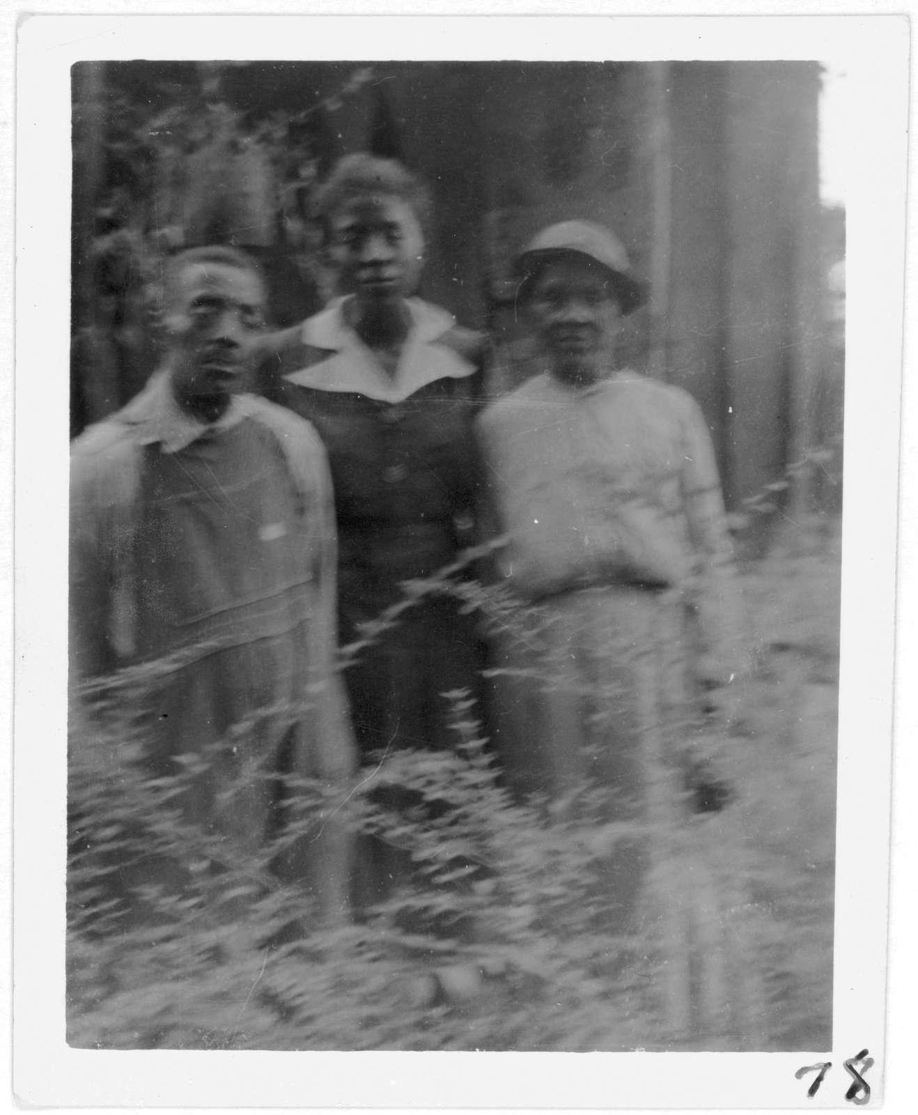 [Uncle Joe McDonald, Aunt Mollie McDonald, and daughter Janie McDonald, outside their farm home, near Livingston, Ala.]