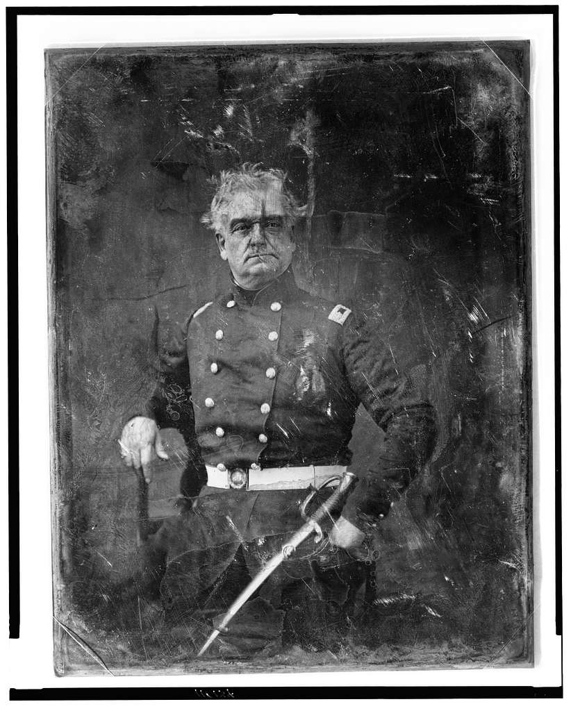 [Unidentified military officer, three-quarter length portrait, facing front, standing, in uniform, with sword]