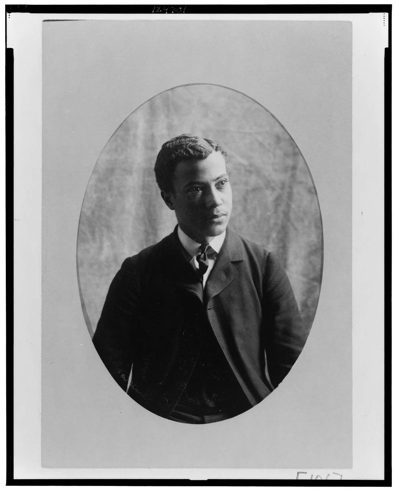 [Young African American man, half-length portrait, facing slightly right]