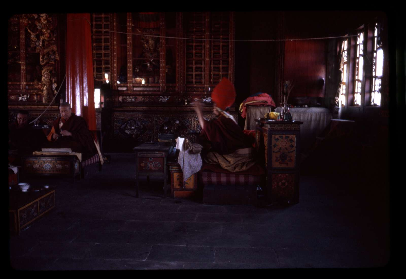 [High Lama and monks at Tsuklakhang Main Temple (Palace Temple) preparing for new year dances and ceremonies, Gangtok, Sikkim]
