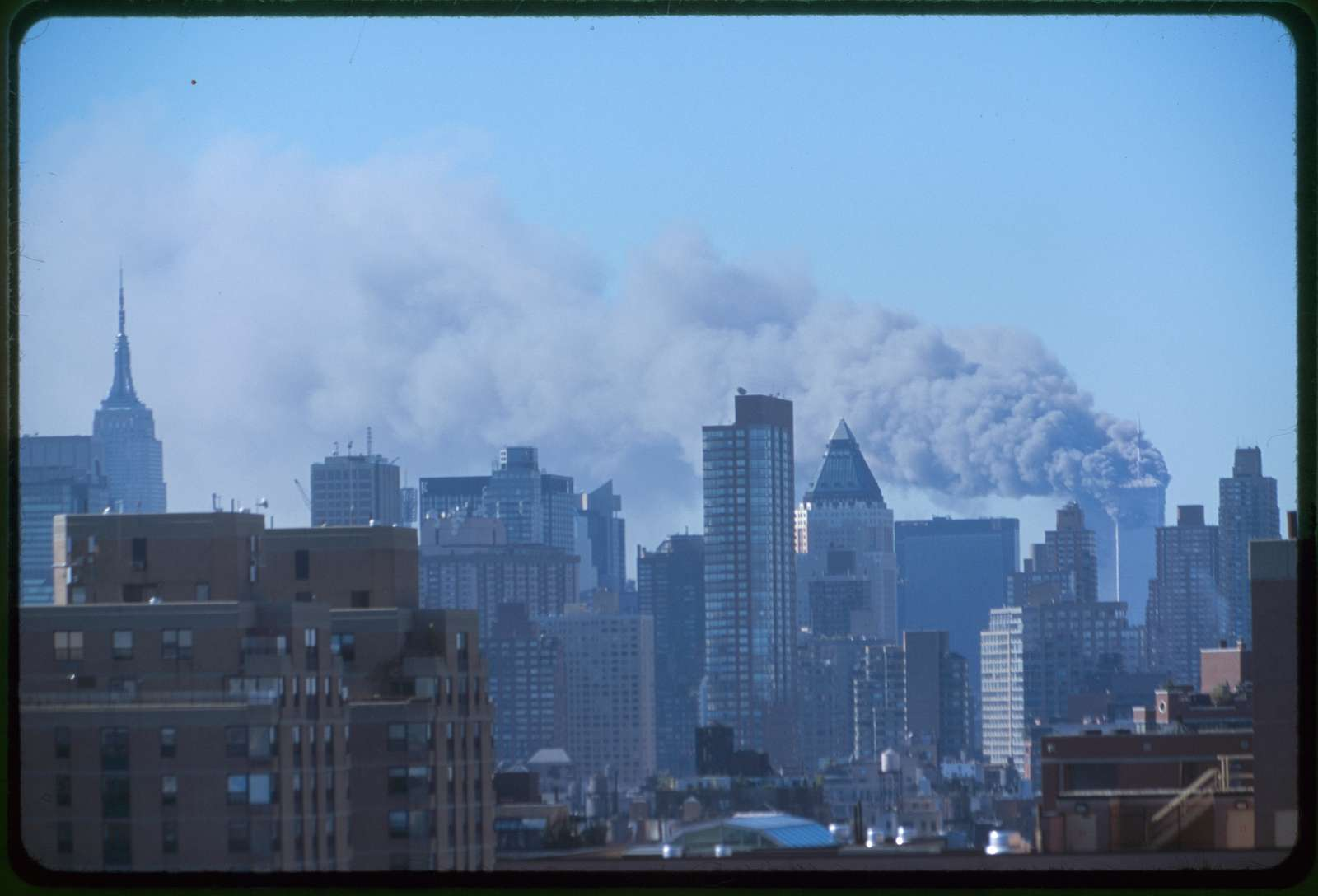 [Skyline of Manhattan with smoke billowing from the Twin Towers following September 11th terrorist attack on World Trade Center, New York City]