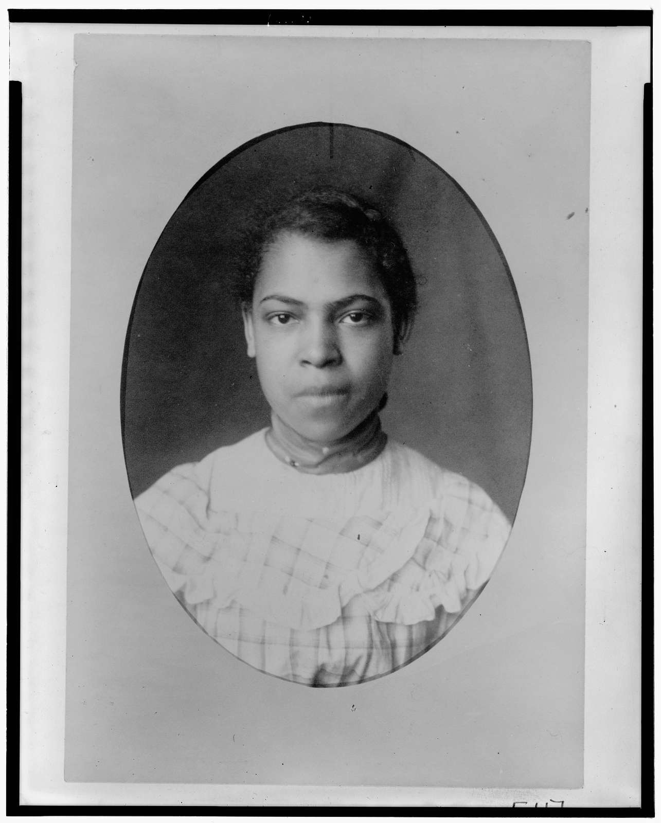 [African American girl, head-and-shoulders portrait, facing front]