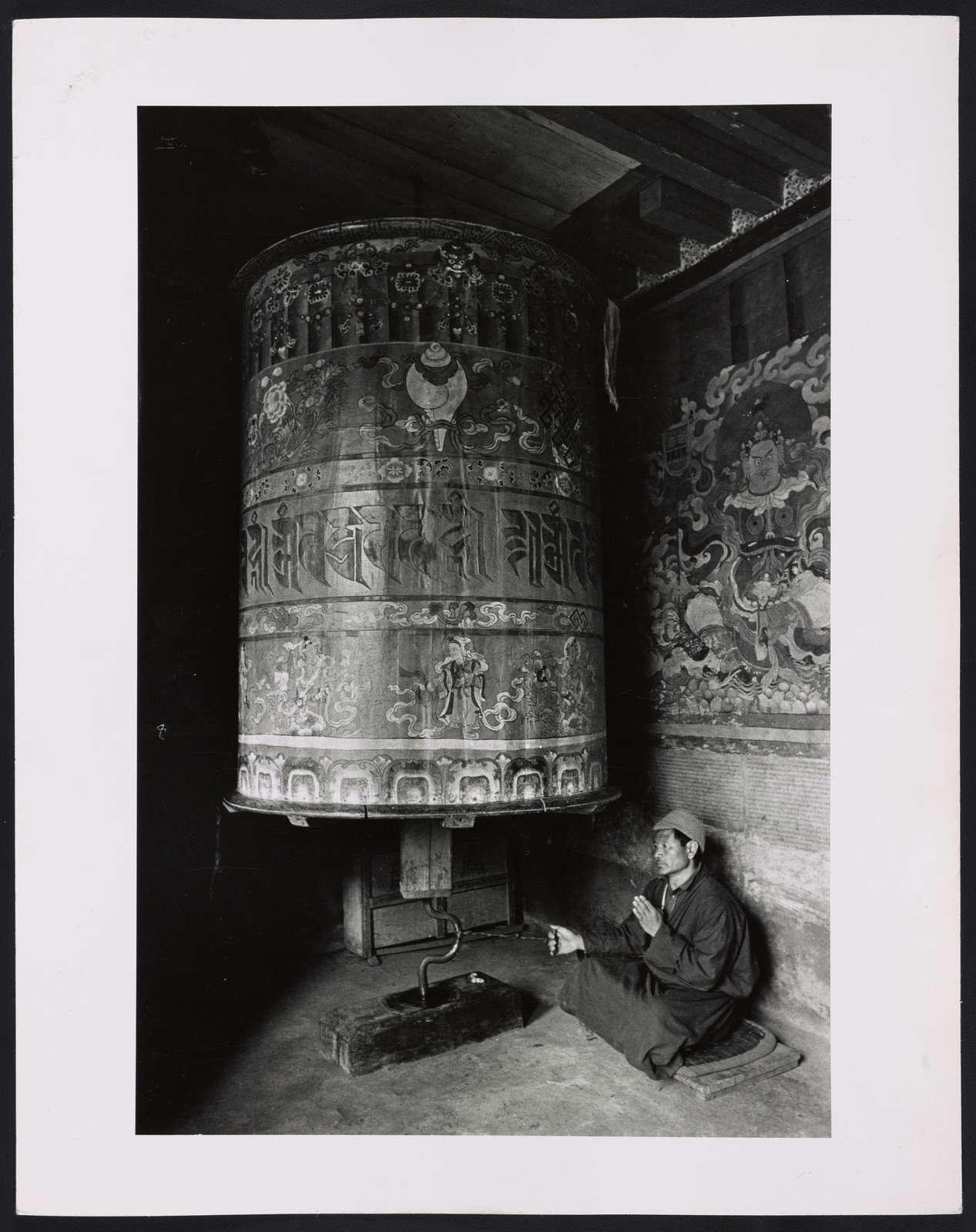 Lama and prayer wheel / Alice S. Kandell.