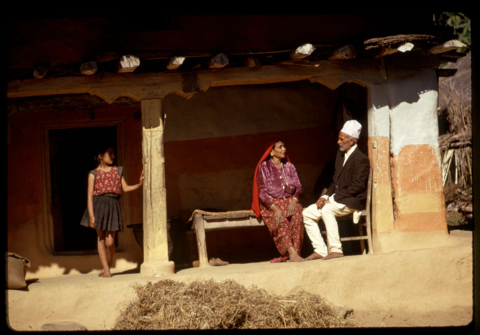 [Nepalese family outside of clay home, Sikkim]
