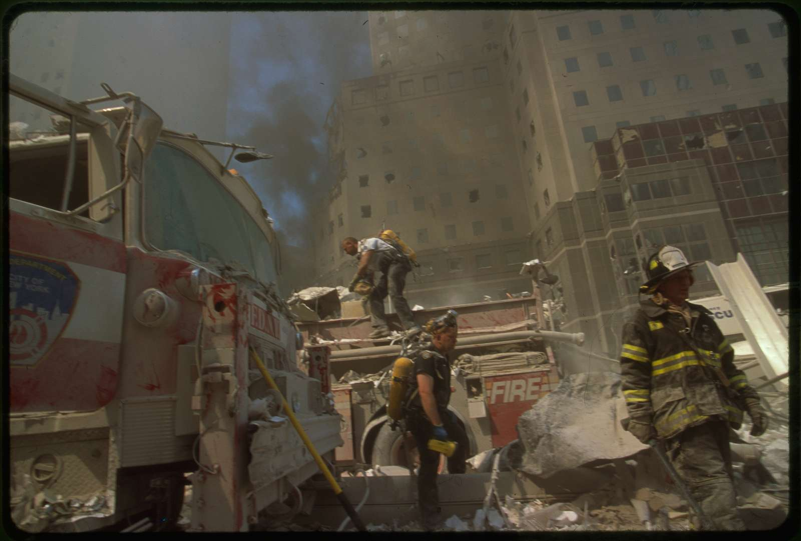 [New York City fire fighters amid debris following September 11th terrorist attack on World Trade Center, New York City]