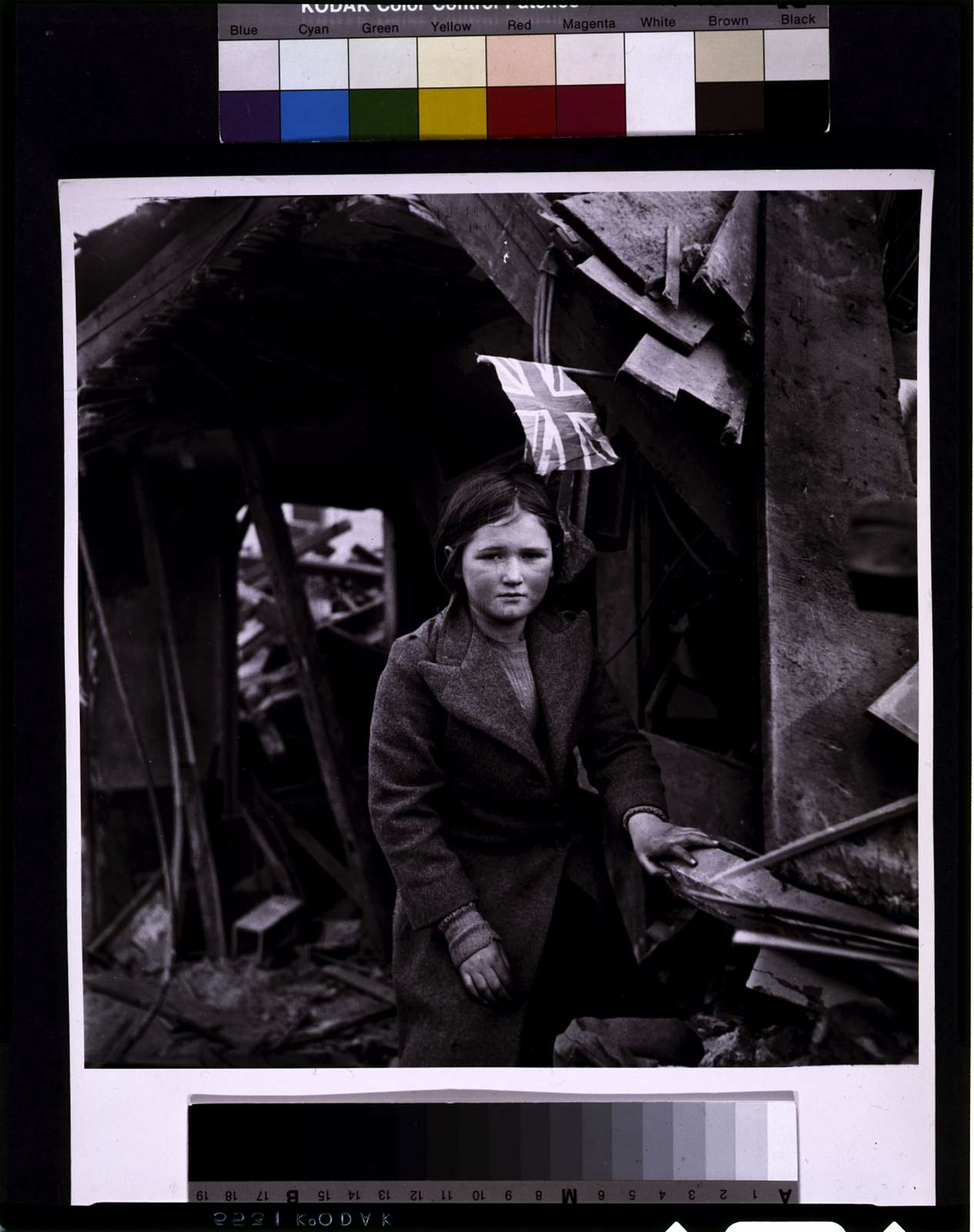 [Battersea incident, England, January 1945--girl among the ruins, British flag overhead]