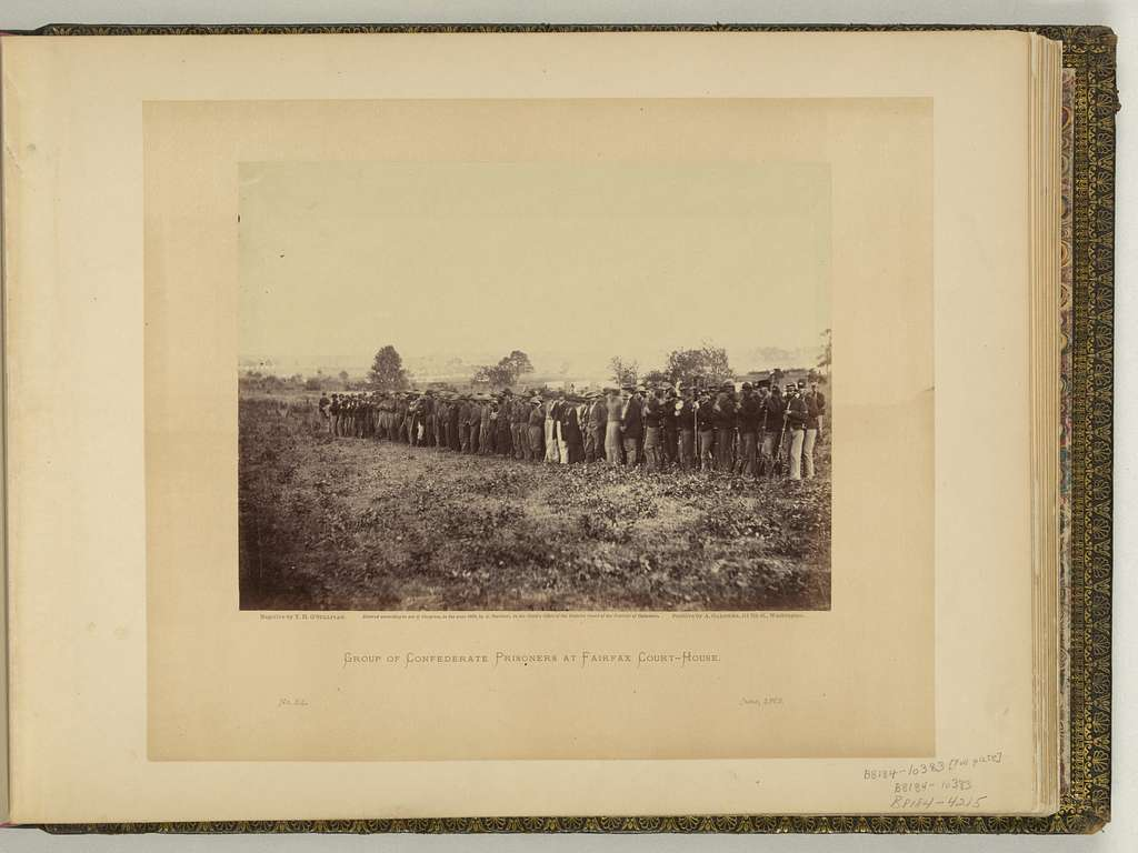 Group of Confederate prisoners at Fairfax court-house / negative by T.H. O'Sullivan ; positive by A. Gardner.