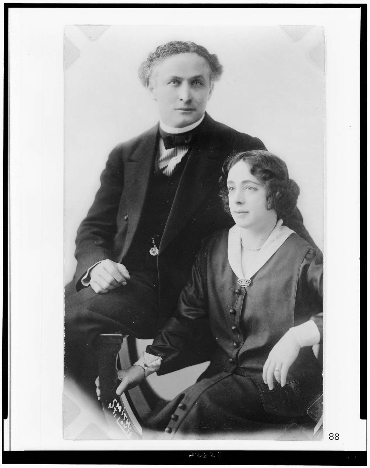 [Harry and Beatrice Houdini, half-length portrait, seated]