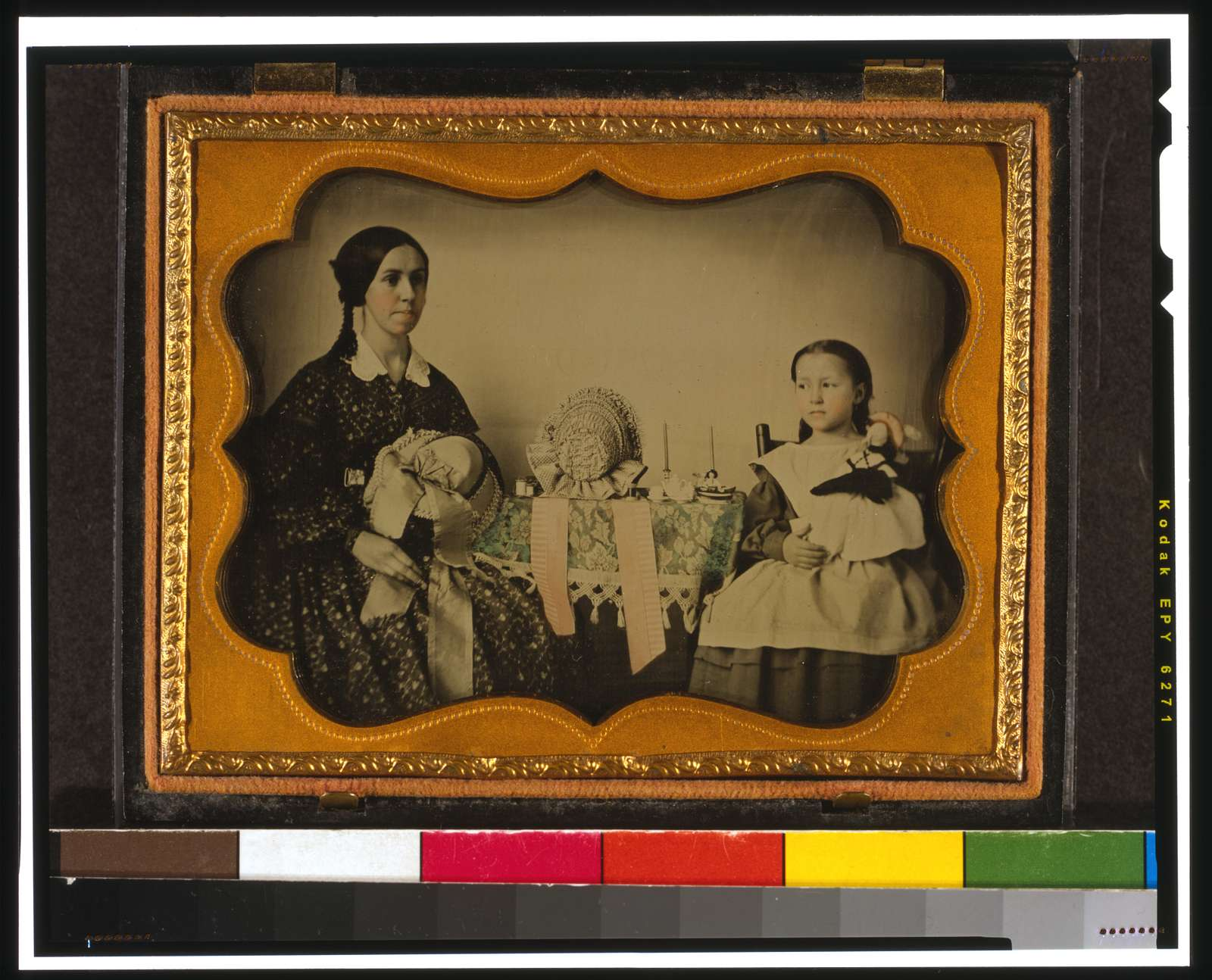 [Milliner and her daughter]