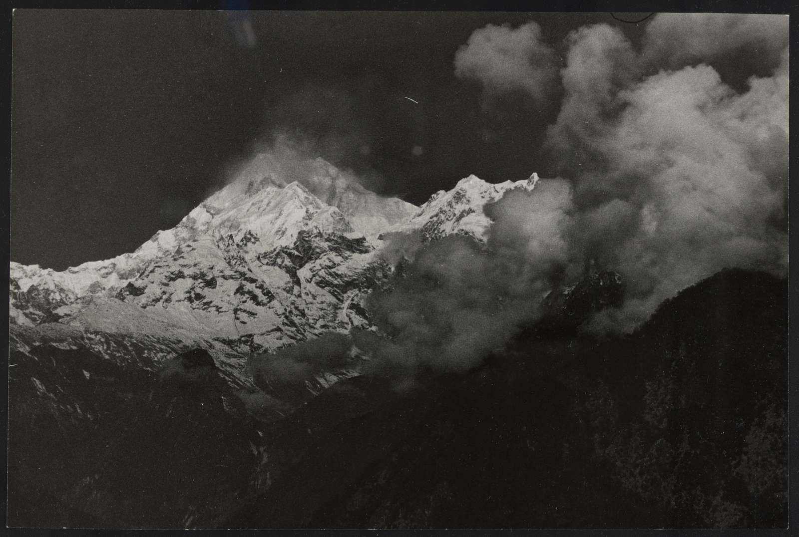 [Snow capped peaks of Mount Kānchenjunga, third highest mountain in the world]