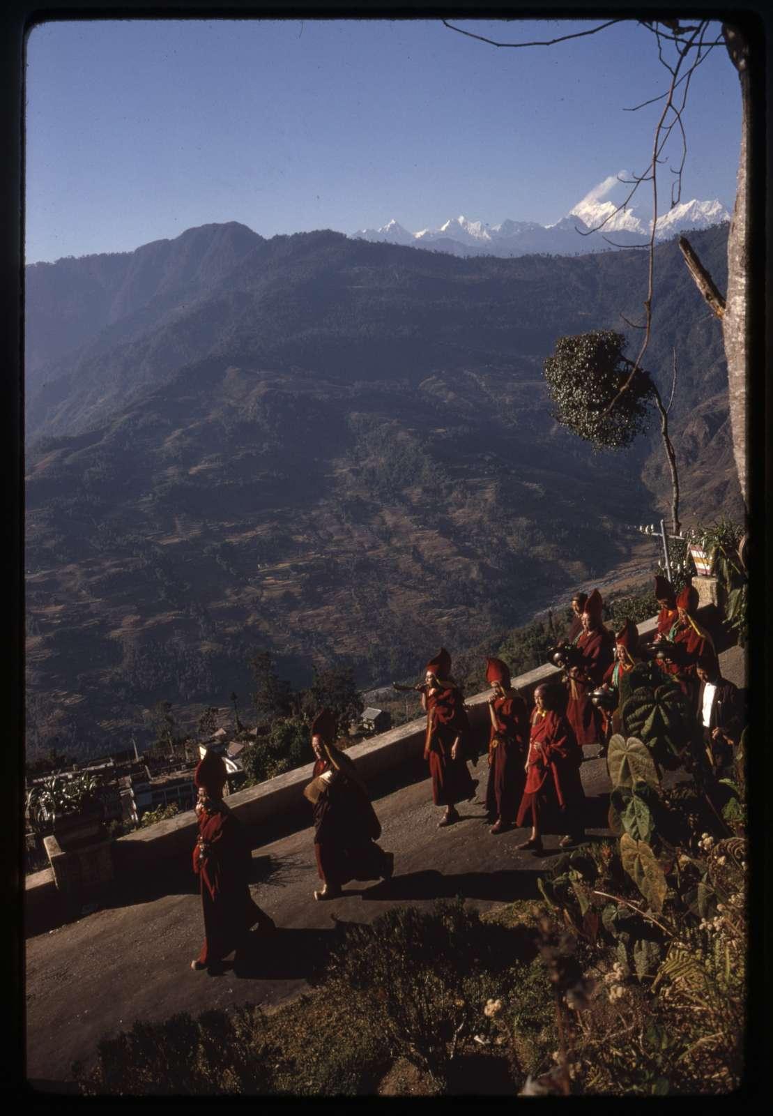 [Monks parade down the mountain to perform religious sacrifice, Sikkim]