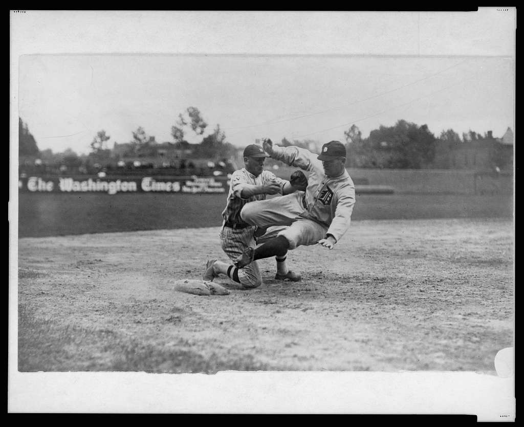 [Detroit Tigers' Harry Heilmann, in a poorly executed slide, is tagged out by Washington Senators' third baseman Howard Shanks. Senators beat the Tigers 6-2]