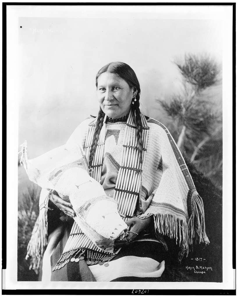 [Mary Martin, Indian, three-quarter length portrait, seated, facing slightly left, holding cradleboard] / Heyn & Matzen, Chicago.