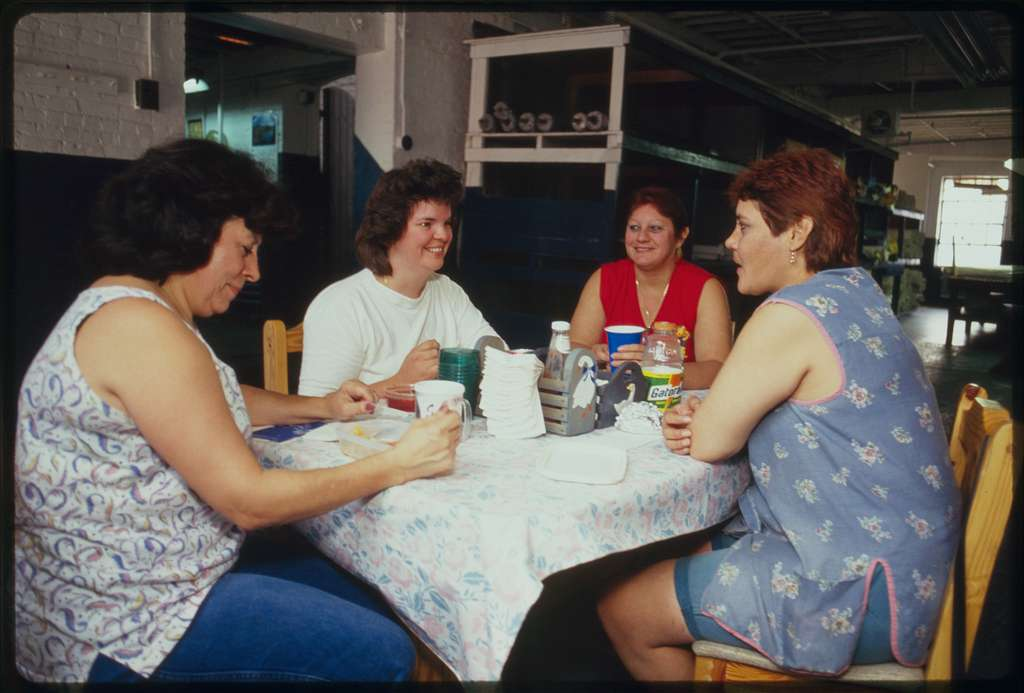 Mill workers eat lunch in room at rear of first floor; left to right:  Teresa Maturano, Cindy Fanslau, Carmen Ortiz, and Gladys Ortiz.