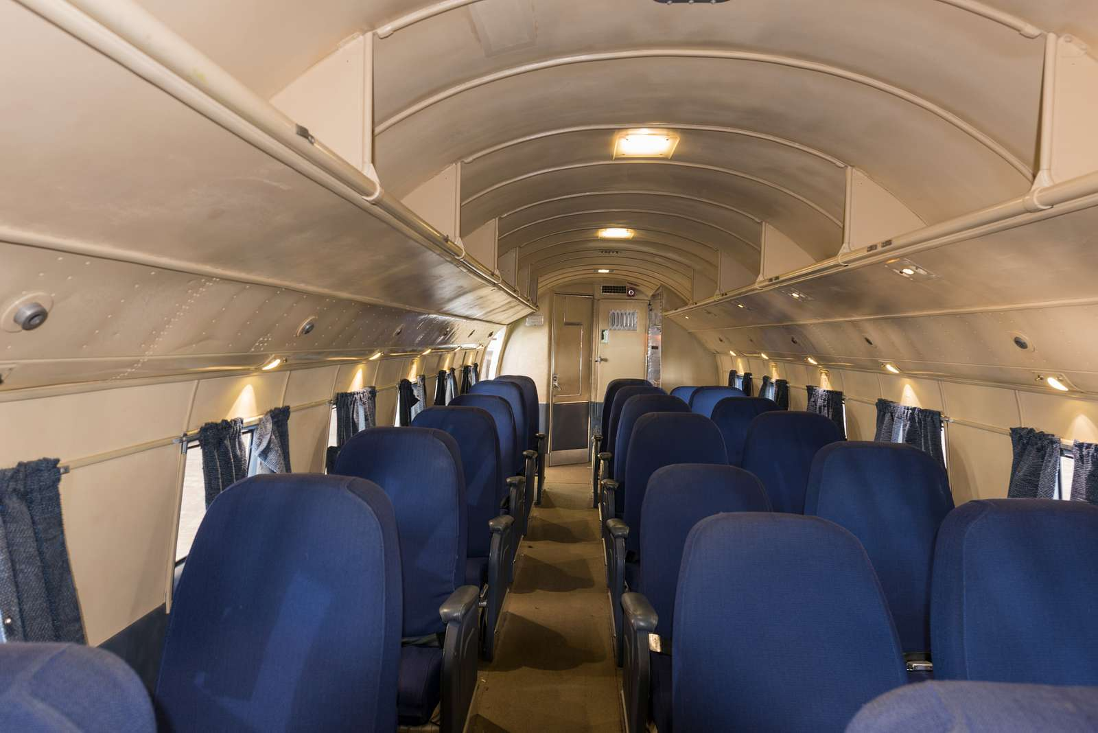 Passenger cabin of the Flagship Knoxville, a fully restored DC-3 aircraft at the American Airlines C.R. Smith Museum on the campus of the American Airlines Flight Academy, at the southern end of DFW International Airport near the world headquarters of American Airlines