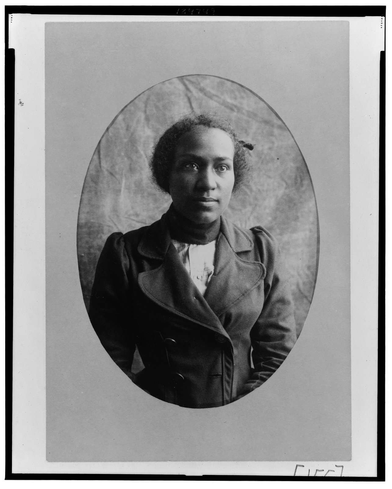 [African American woman, half-length portrait, facing front]