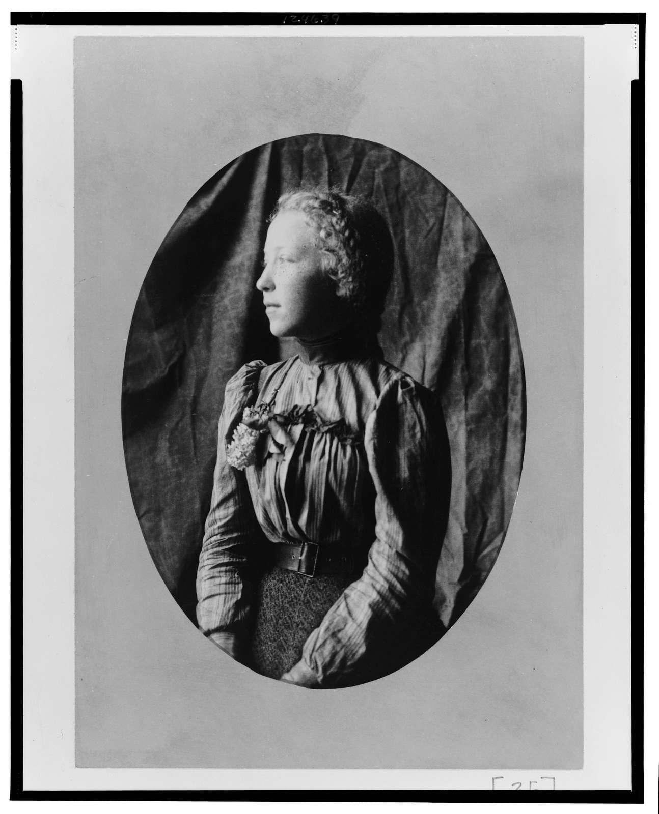 [African American woman, half-length portrait, facing left]