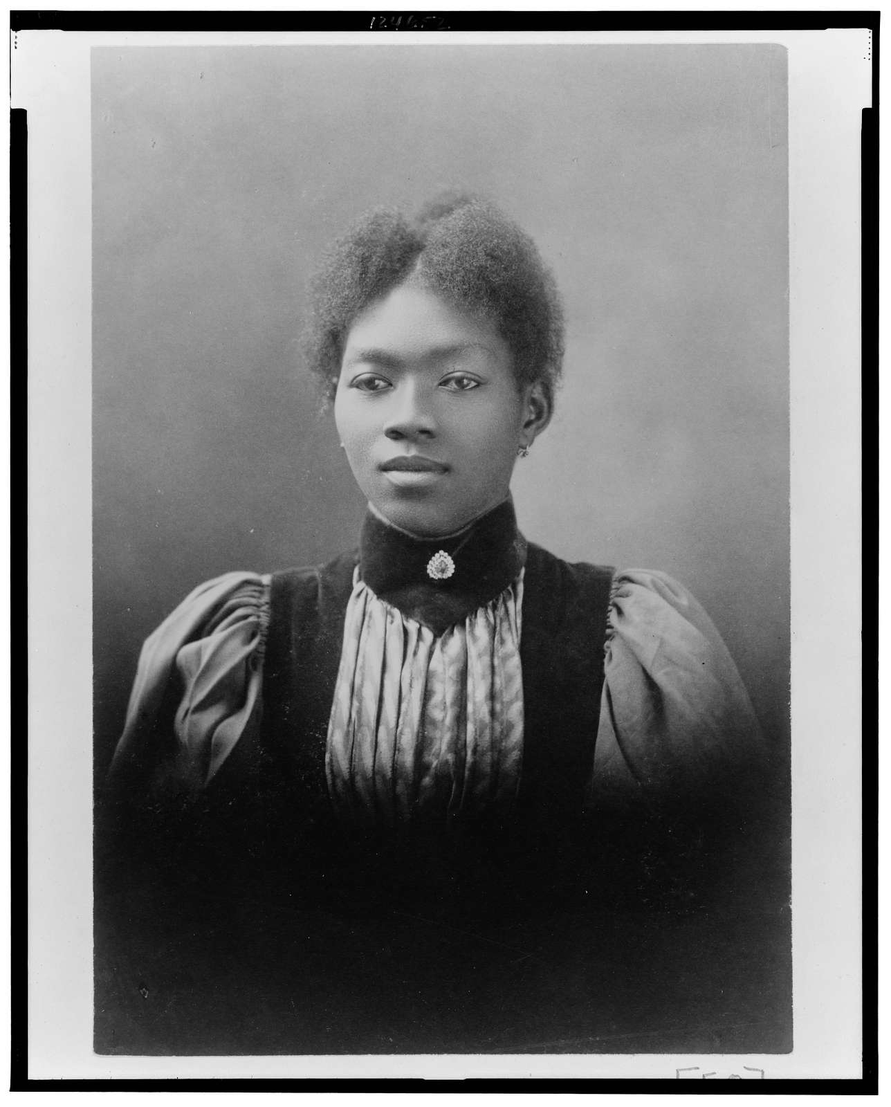 [African American woman, head-and-shoulders portrait, facing slightly left]