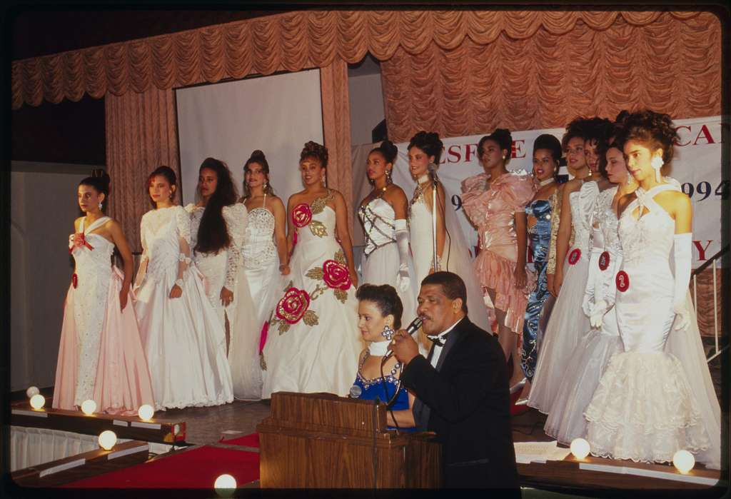 Contestants on stage in evening gowns.