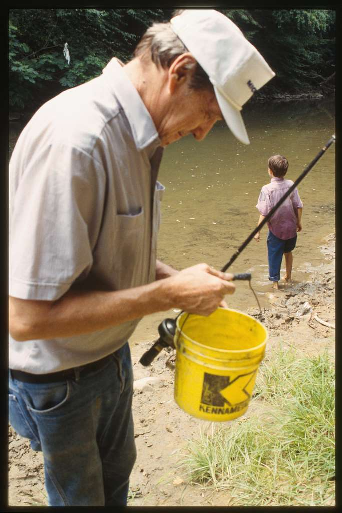 Dave Bailey with pole and bucket for fishing