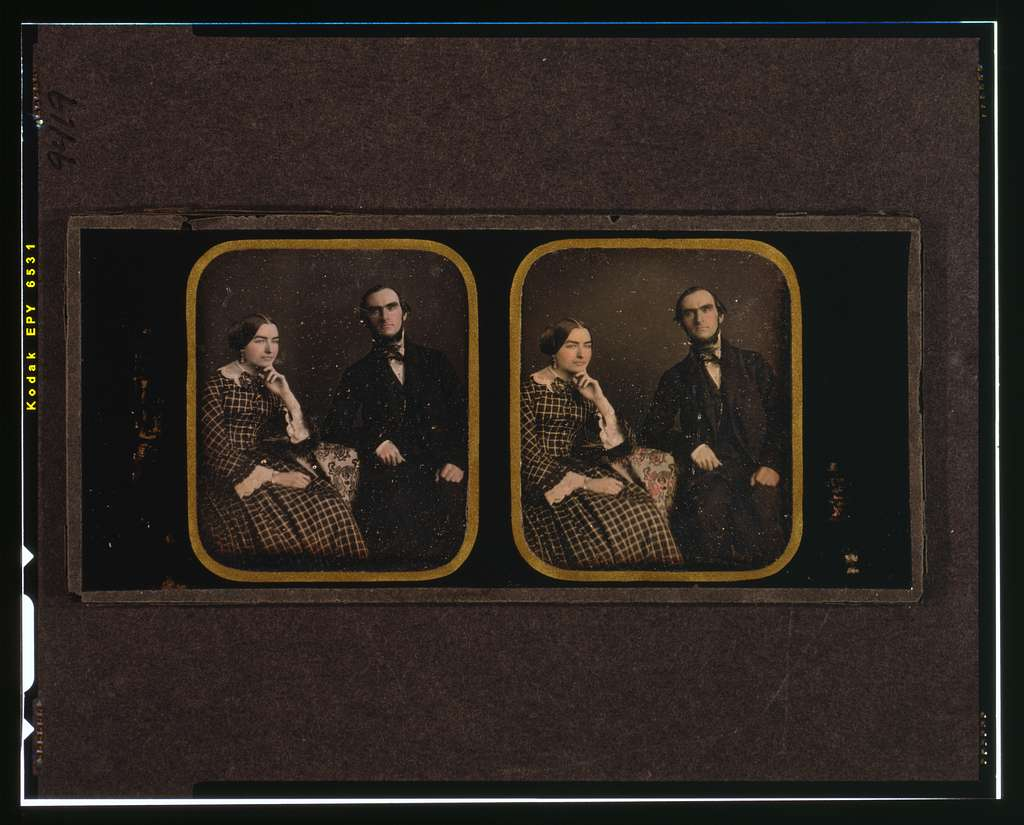 [John and Fanny Stevenson, three-quarters length, seated, with arms resting on table with tablecloth]