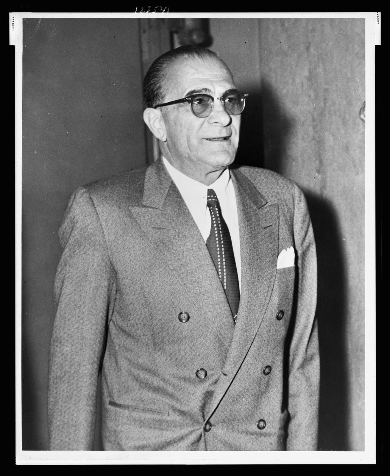 [Vito Genovese, half-length portrait, standing, facing right] / World Telegram & Sun photo by Phil Stanziola.