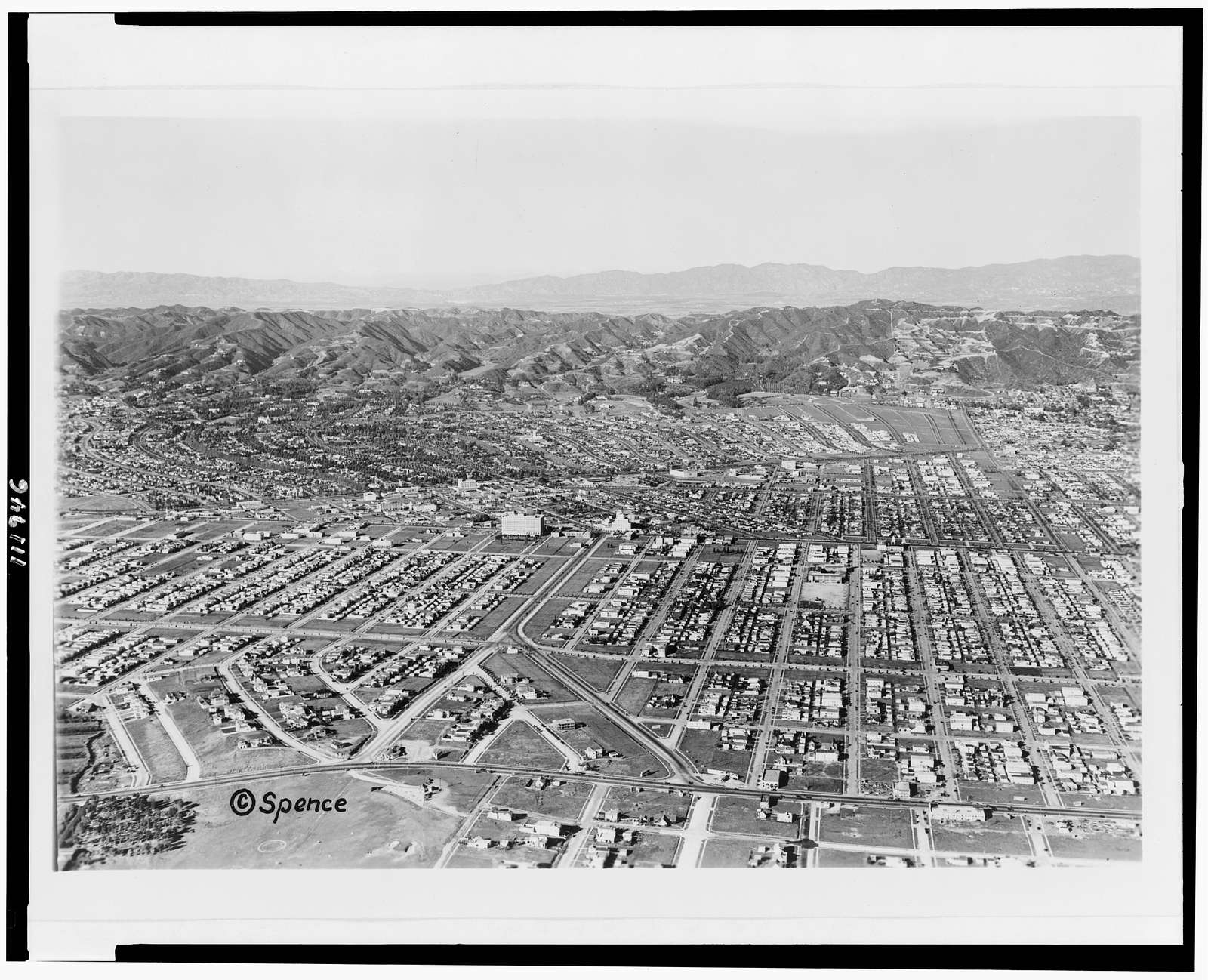 [Aerial view of Beverly Hills, north of Pico Blvd.]