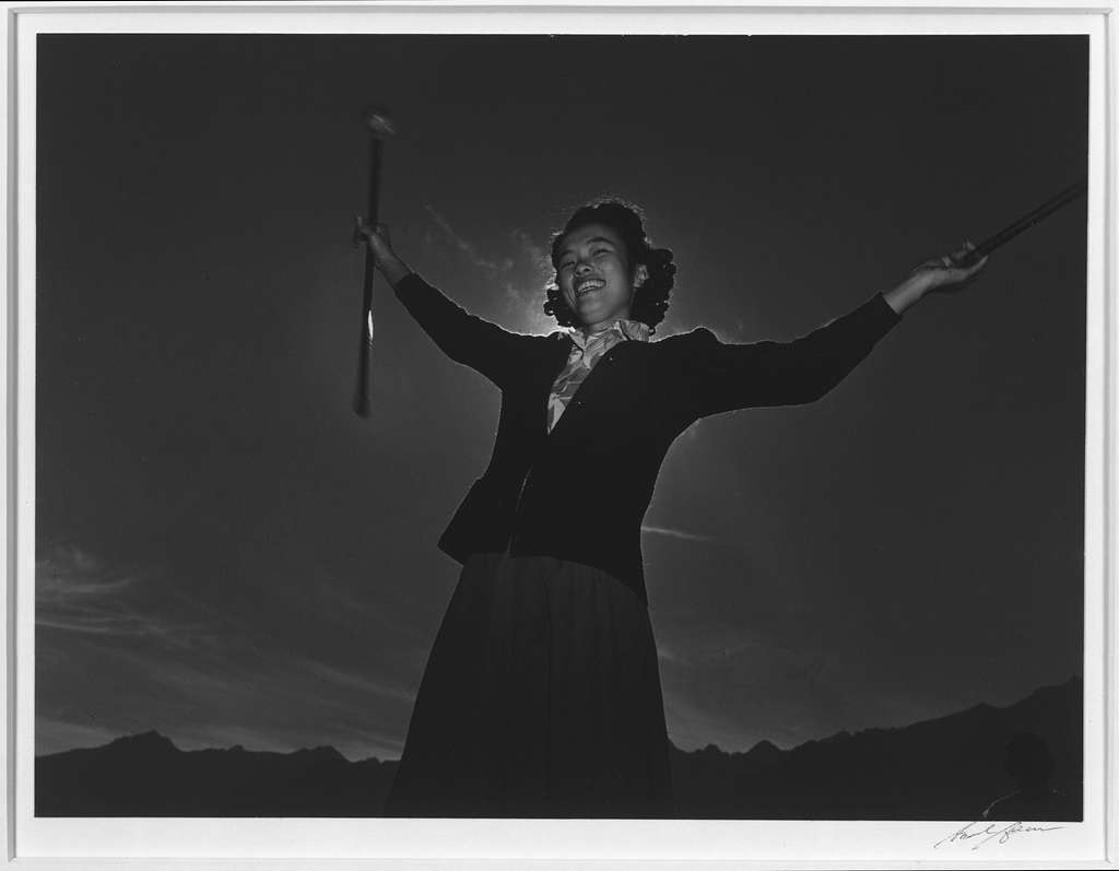 Baton practice, Florence Kuwata, Manzanar Relocation Center / photograph by Ansel Adams.