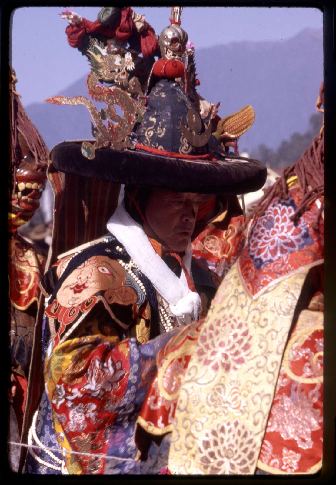 [Black Hat Lama in a procession down the mountain to sacrifice objects, Sikkim]