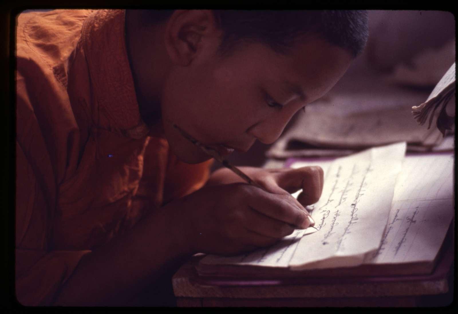 [Karmapa Lama's successor studying penmanship, Sikkim]