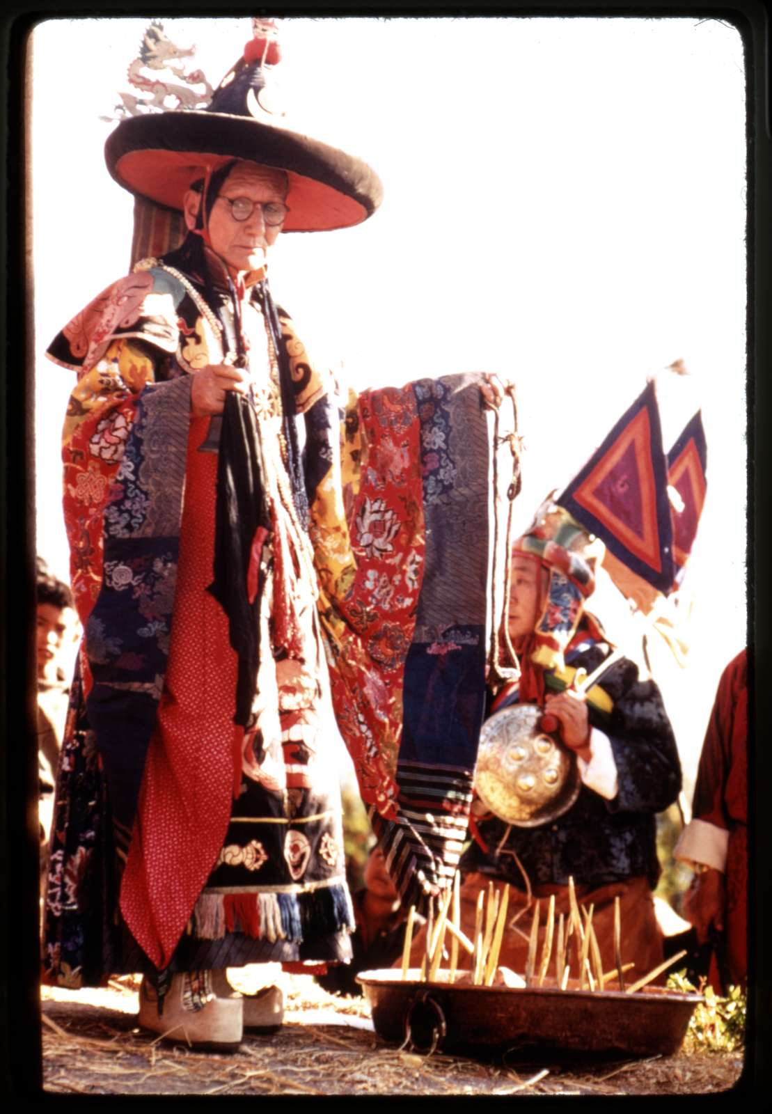 [Black Hat Lama preparing for religious sacrifice at the New Year's ceremony, Sikkim]