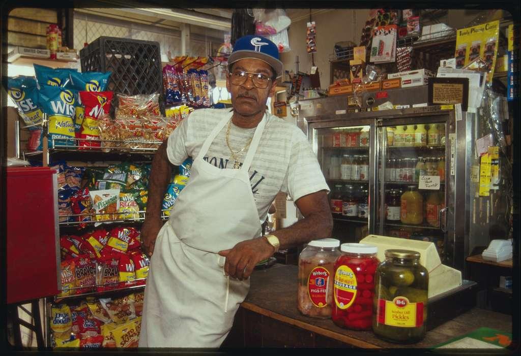 Proprietor Doug Owens poses beside the store's counter.