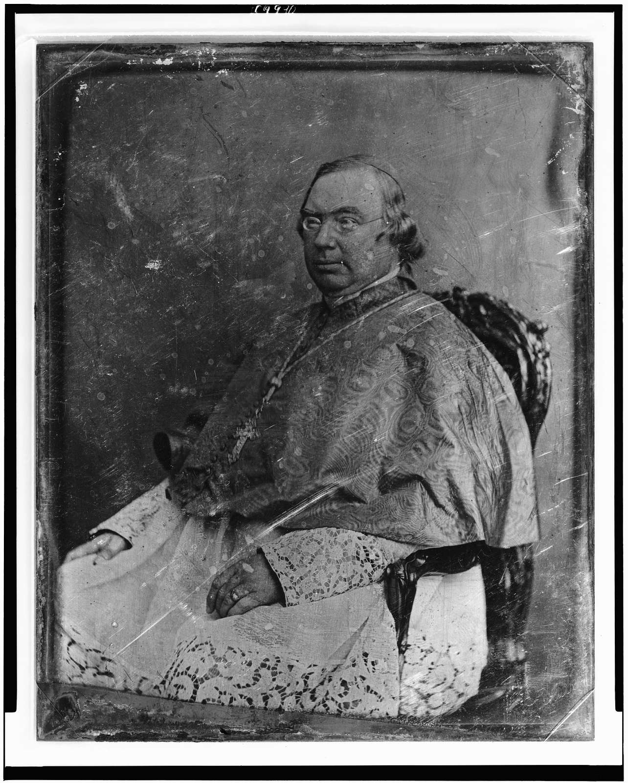[Nicholas Patrick Wiseman, three-quarter length portrait, seated in armchair, three-quarters to the left, in clerical robe]
