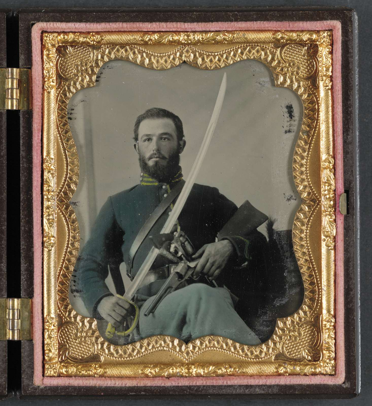 [Unidentified soldier in Union uniform with stocked Colt pistol, Remington, and cavalry saber